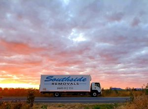 Southside Removals Van on the Road at Sunset